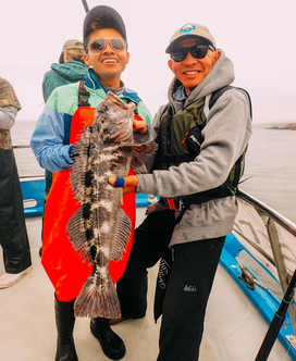 CCFRP photo with volunteer angler and Eduardo showing a lingcod fish.